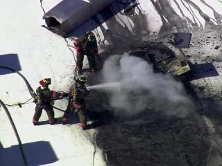 Firefighters extinguish a March 15, 2013, fire at the El Rodeo restaurant in the Brightleaf Square office and retail complex in Durham.