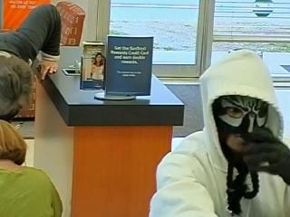 Creedmoor police are investigating an armed bank robbery on Main Street Wednesday afternoon that briefly placed local schools on lockdown.