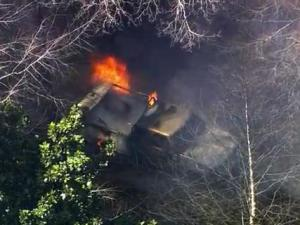 Wake County authorities respond to a truck fire in the woods near South Lakeside and Stockton drives in west Raleigh on March 28, 2013.