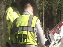 State troopers investigate a crash Thursday that killed three men in Fayetteville.