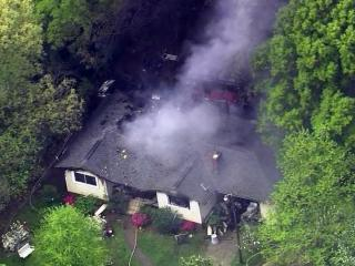 Firefighters battled an April 19, 2013, house fire on Barclay Drive in southwest Raleigh in which several explosions were reported.