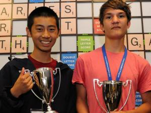 Raymond Gao and Kevin Bowerman pose with the winning 2013 National School Scrabble trophies in front of the world's largest Scrabble board. Photo courtesy of PR Newswire.