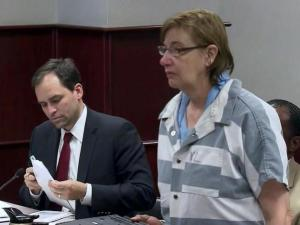 Dottie Delaney Amtey makes her first court appearance on May 9, 2013, after being charged with murder in the death of her husband, Sharad Ramchandrarao Amtey, 77.