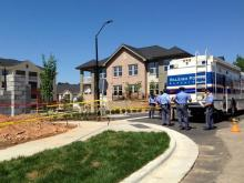 Police investigate a death at the Allister North Hills Apartments complex in north Raleigh on May 14, 2013.