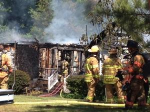 Fire destroyed a home on Fawncrest Drive in Garner on Tuesday, May 14, 2013, authorities said. Photo by Kelly Riner