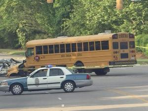 Raleigh police closed all lanes of Atlantic Avenue between Spring Forest and Millbrook roads in north Raleigh Wednesday morning after a wreck involving a school bus and car.