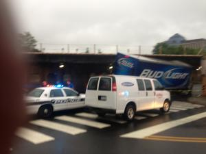Durham police try to to free a Bud Light truck from under a bridge at Pettigrew and Chapel Hill streets Monday morning, June 3, 2013. (Photo courtesy of a WRAL viewer)