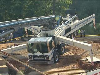 Two people were injured Wednesday morning when a concrete truck tipped in the 6100 block of Tryon Road, Cary officials said.