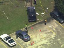 A SKY5 aerial photo shows a police investigation of a June 28 shooting on Owens Drive in Fayetteville.