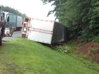 A tractor-trailer carrying watermelons overturned Tuesday morning while traveling northbound on Interstate 95 near Selma.