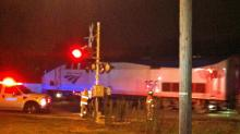 IMAGES: Woman narrowly avoids being hit by train in Raleigh