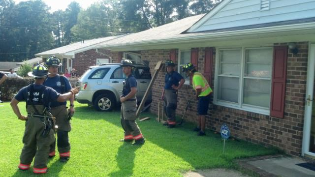 A 41-year-old man taking his driver's license road test with an instructor on Monday afternoon lost control of the driving school's SUV and plowed into a home on Cook Road in Durham.