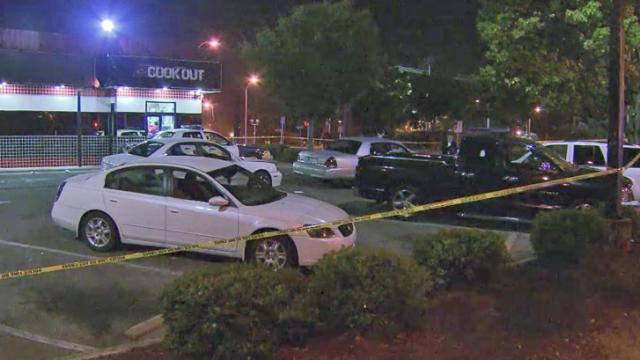 Raleigh police think the report of shots fired at a downtown Cook-Out may be linked to a car crash nearby.