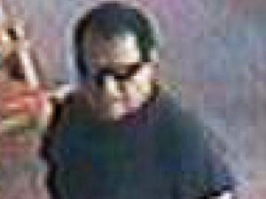 Police released this security video image of a man wanted in a sexual assault in Chapel Hill.