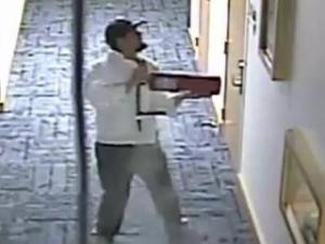 Security video at the Nature Research Center captured a bearded man wearing a dark hat, white jacket and dark clothing inside the building shortly after 3:30 a.m. Sept. 22, 2013.