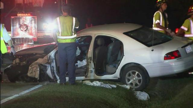 Four people were injured Tuesday night when the car they were traveling in crashed into a utility pole in Durham, police said.