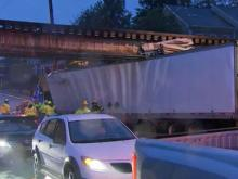Raleigh police closed three lanes of Peace Street between Capital Boulevard and Glenwood Avenue early Thursday after a tractor-trailer struck a railroad bridge.