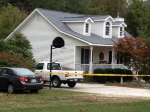 Crime scene tape surrounds a two-story home at 11378 N.C. Highway 210 after a shooting that happened there Oct. 12, 2013.