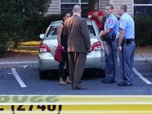 Raleigh police respond to a shooting Oct. 16, 2013, at Westridge Woods Apartments at 208 Buck Jones Road.