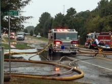 Authorities shut down Hillsborough Street in west Raleigh Saturday morning due to a fire.
