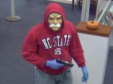 Authorities released these security video images of an Oct. 25 robbery at PNC Bank on Governor's Drive in Chapel Hill.