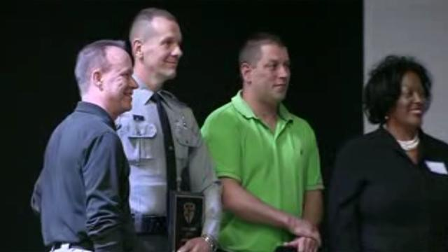 Troopers Jerimy Mathis, second from left, and Michael Potts, second from right, receive the Hometown Hero Award from The Emergency Chaplains on Oct. 27, 2013.