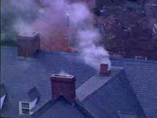 Smoke poured from chimneys and vents Tuesday, Nov. 5, 2013, on top of Cobb Dormitory at UNC.