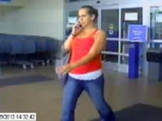 Apex police are looking for the woman in this surveillance image who is wanted for questioning in two cases involving the use of stolen credit cards.