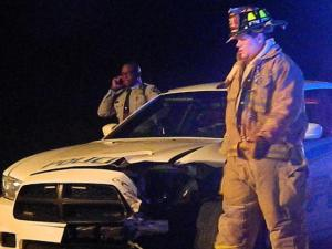 A Vass police officer was involved in a head-on collision just outside the Moore County town Tuesday evening, Nov. 19, 2013. (Photo by Billy Marts)