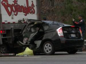 The driver of a Toyota Prius was pinned in the car after colliding with a tractor-trailer on westbound Interstate 540 early Monday, Dec. 2, 2013.