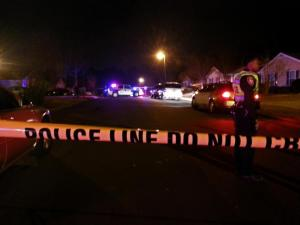 Durham police investigate a fatal shooting Monday night, Dec. 2, 2013, on Fidelity Drive, off North Miami Boulevard.