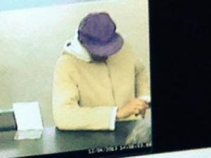 Durham police are looking for the man in this surveillance image in connection with a Dec. 4, 2013, robbery at Yadkin Bank, at 115 E. Carver St.