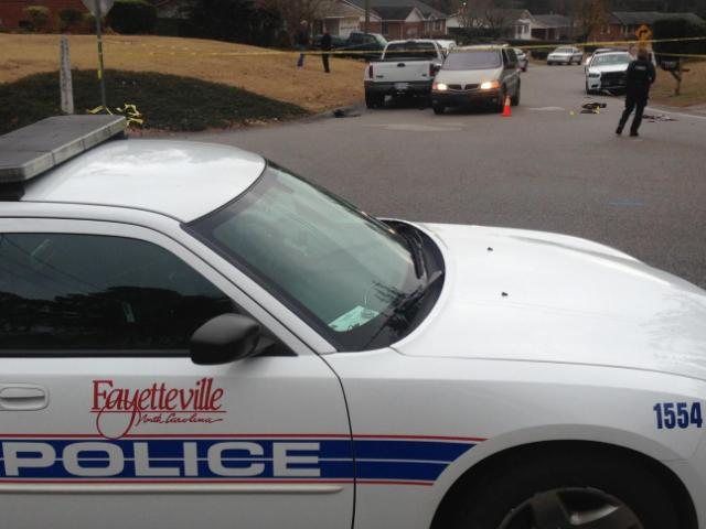 Police say a man was found shot in a van at the corner of Devonshire Drive and Cheltenham Road on Dec. 4, 2013.<br/>Photographer: Michael Joyner