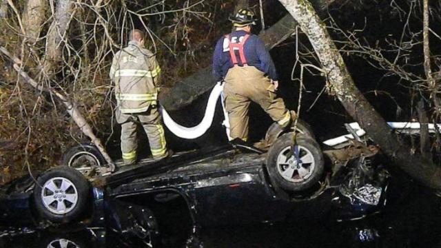 Two people were pulled from a car that went off a bridge and into a creek in western Harnett County on Dec. 9, 2013. (Photo by Billy Marts)