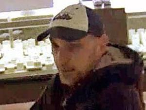 Police are trying to identify a man who tried to hold up two businesses on Falls of Neuse Road in north Raleigh on Dec. 7, 2013.