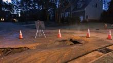 IMAGE: Water main rupture closes road in Cary neighborhood