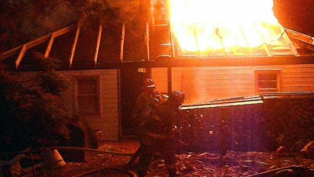 Emergency responders were sent to a reported house fire with family pets trapped in the burning house Friday afternoon.