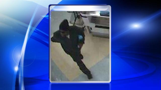 Clayton police are searching for this man, shown on security camera, who robbed a Food Lion on U.S. Highway 70 on Dec. 15, 2013.