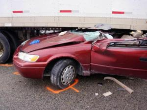 A driver suffered non-life-threatening injuries on Jan. 10, 2014, after the top of his car was sheared off when it went under a tractor-trailer in Aberdeen, authorities said. (Photo courtesy of Frank Staples)
