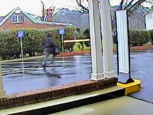 Spring Hope police released this security image of a robber running from a PNC Bank branch on Jan. 10, 2014.