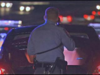 Police stopped traffic on I-40 Friday night to detain three suspects.