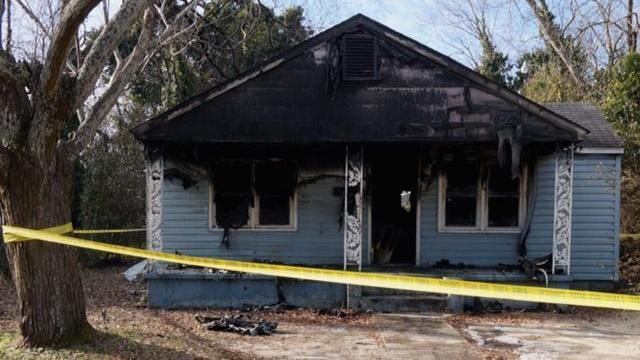 Two vacant homes on Link Street in Fayetteville, including this one at 506 Link St., were damaged early Thursday, Jan. 23, 2014, in separate fires reported about two hours apart. (Gilber Baez/WRAL)