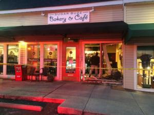 Broken glass and twisted beams show where a car crashed into the Sugar Buzz Bakery & Cafe Friday, Jan. 24, 2014.