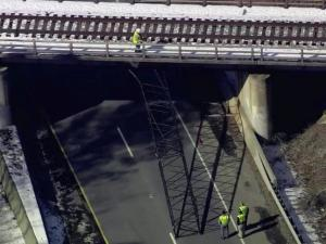 Westbound U.S. Highway 64 was closed between Laura Duncan Road and the Salem Street exit in Apex on Jan. 31, 2014, after a crane became stuck under a railroad overpass, police said.