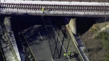 IMAGE: Crane stuck under bridge closes US 64 in Apex