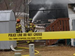 An adult and two children were taken to a local hospital after a fire at 155 Branchwater Circle on Sunday, Feb. 9, 2014. (Jamie Munden/WRAL)