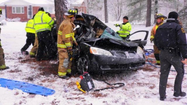 Rescue crews extricate two people from a car that slammed into a tree off Sandpit Road in Aberdeen on Feb. 11, 2014. (Photo courtesy Frank Staples)