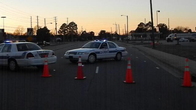 Fayetteville police block off the interstection of Morganton and North Reilly Roads on Sunday, Feb. 16, 2014, after a tractor-trailer truck hit a utility pole. (Billy Marts/WRAL Contributor)