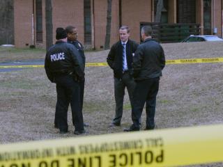 Police taped off a portion of a Durham apartment complex on Glasson Street early Wednesday, Feb. 26, 2014, while investigating a crime.