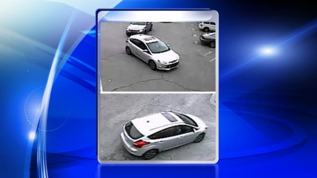 Raleigh police are looking for two men who they say were in this silver hatchback, caught on security video at Broughton High School on March 5, 2014. (Source: Raleigh Police Department)